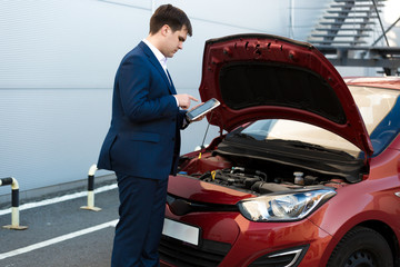 sales manager making photo under car bonnet