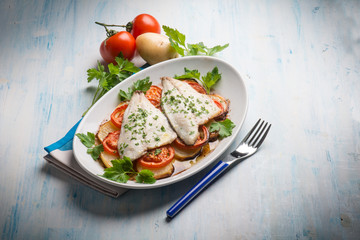 fish with potatoes and tomatoes