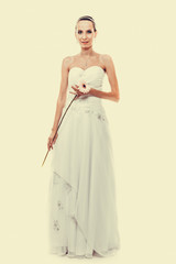 Full length bride in white wedding gown