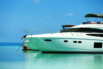 Yacht parked at jetty in Baros Maldives