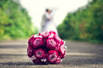 Bouquet of red roses lying on the ground