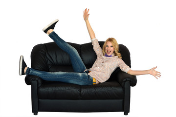 Enthusiastic young woman laing on the sofa isolated on white