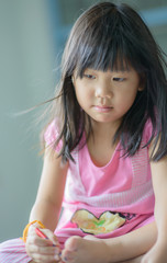 portrait of cute asian girl thinking something