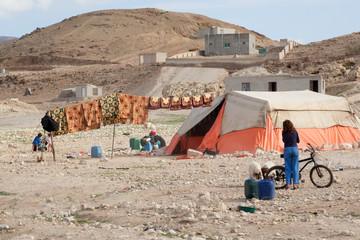Nomad Bedouin tents in dry Jordan landscape