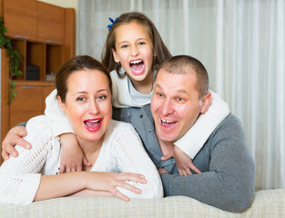 Little girl with parents posing