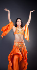 Belly Dance Performance. Grey background.