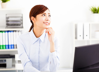 young  business woman thinking in the office