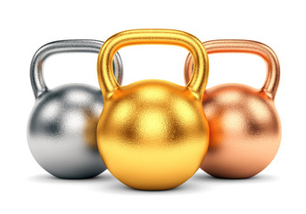 Golden, silver and bronze kettle bells