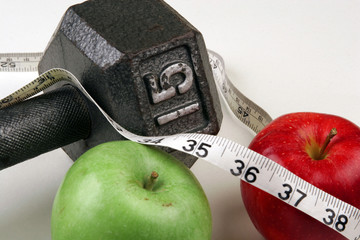 Measuring tape with weights and apples