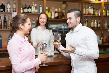Young couple with wine at bar