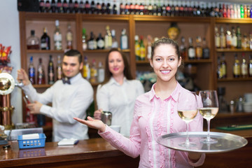 Waitress and barmen working
