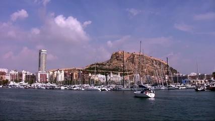 Sailboat enterin in Alicante city harbor