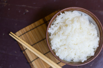 Steamed rice in a bowl and chopstick