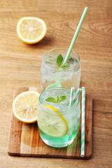cold soft drink from apple syrup and mint