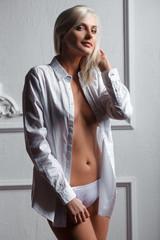 Beautiful sexy woman in shirt and panties
