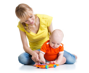 baby and his mom play musical toys