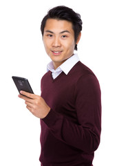 Young businessman using a mobile phone
