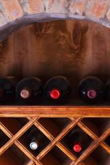 Wine bottles stored in a shelves