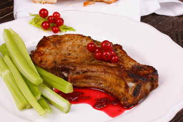 Fried pork chop with red currant sauce and celery