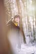 Man during winter walk in forest