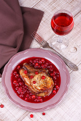 Fried pork chop with cranberry and wine sauce