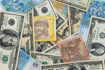 Background banknotes of us dollars and Ukrainian hryvnia