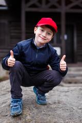 Little schoolboy thumbs up outdoor