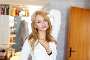 Fresh blonde woman in bathroom