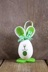 Green Easter bunny on the boards