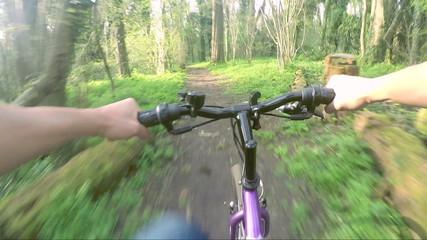 Biker going through woods, first person view