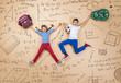 Leinwanddruck Bild - Cute boy and girl learning playfully in frot of a big blackboard