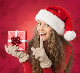 Christmas. Attractive Young Woman in Sweater with Red Gift Box
