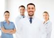 smiling male doctor in white coat
