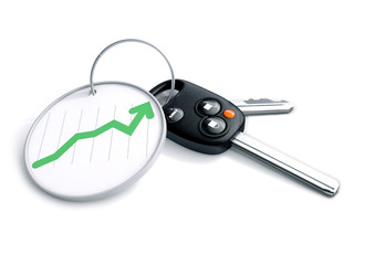 Car keys with keyring and positive sales graph