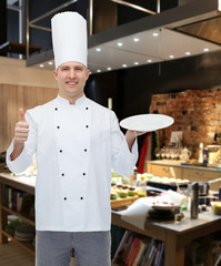 happy male chef cook showing thumbs up and plate