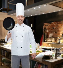happy male chef cook holding frying pan