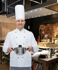 happy male chef cook holding pot