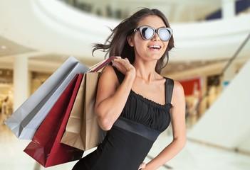 Girl. Beautiful brunette young woman wearing dress and walking