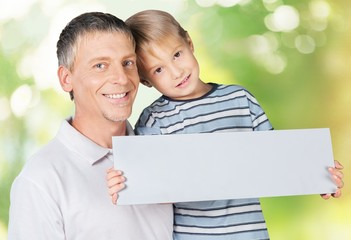 Business. Business owner and son holding an open sign