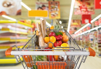 Supermarket. Shopping in a hurry: shelves blur as cart races