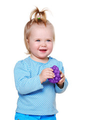 happy little girl holding toys fruits