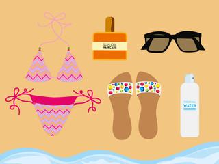 Beach accessories on beach sand. Vector design.