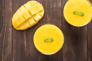 Top shot mango smoothie on wooden table