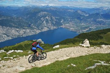 Mountainbiker at the trail near Garda Lake,Italy