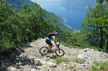 Mountainbiker at the trail near Garda Lake