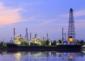 Oil refinery and Ship fuel delivery at twilight in bangkok