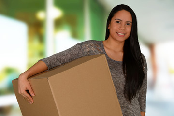 Young woman carrying a box