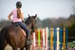 Young woman show jumping with horse - 81538619