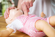 Leinwanddruck Bild - Infant CPR two finger cvompression