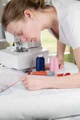 Woman drawing a sewing pattern